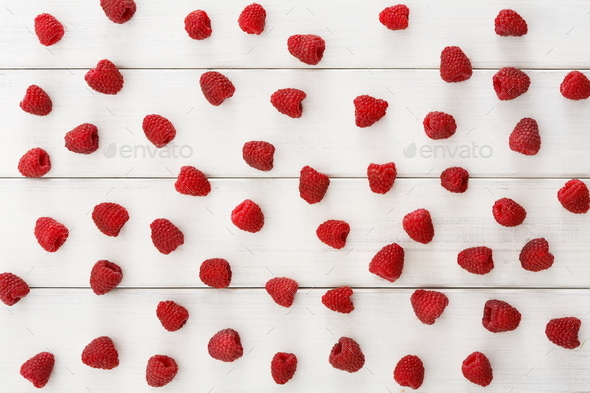 Raspberries on white wooden table top view - Stock Photo - Images