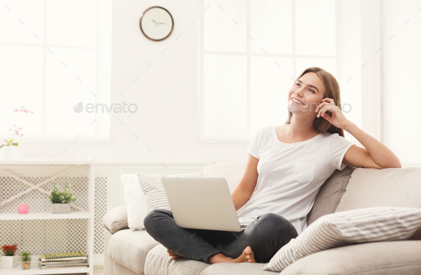 Young girl with laptop indoors - Stock Photo - Images