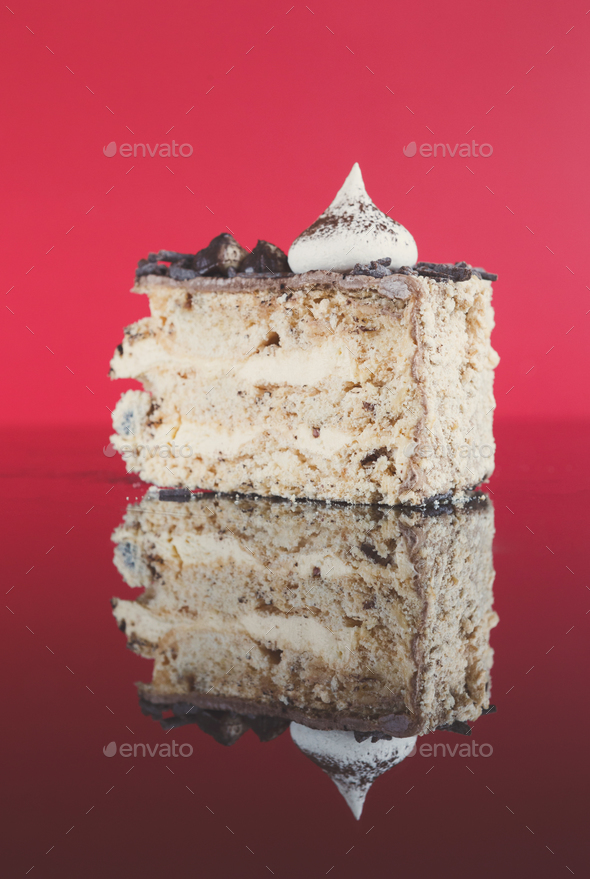 Meringue cake slice with hazelnuts and buttercream - Stock Photo - Images