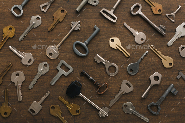 Many different keys on wood - Stock Photo - Images