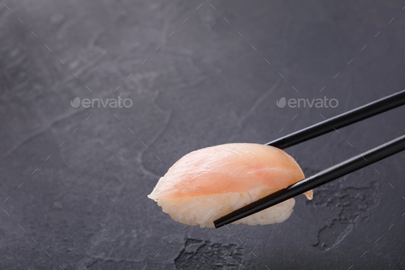 Eating sushi at restaurant, japanese cuisine - Stock Photo - Images