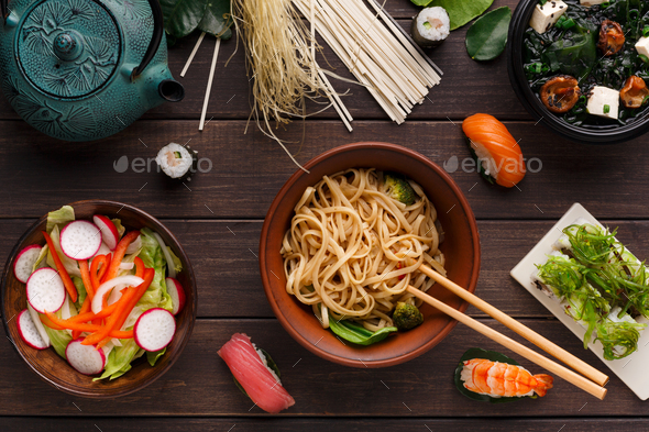 Asian food on wooden background, copy space - Stock Photo - Images