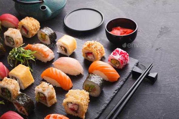 Sushi and rolls background, japanese cuisine - Stock Photo - Images