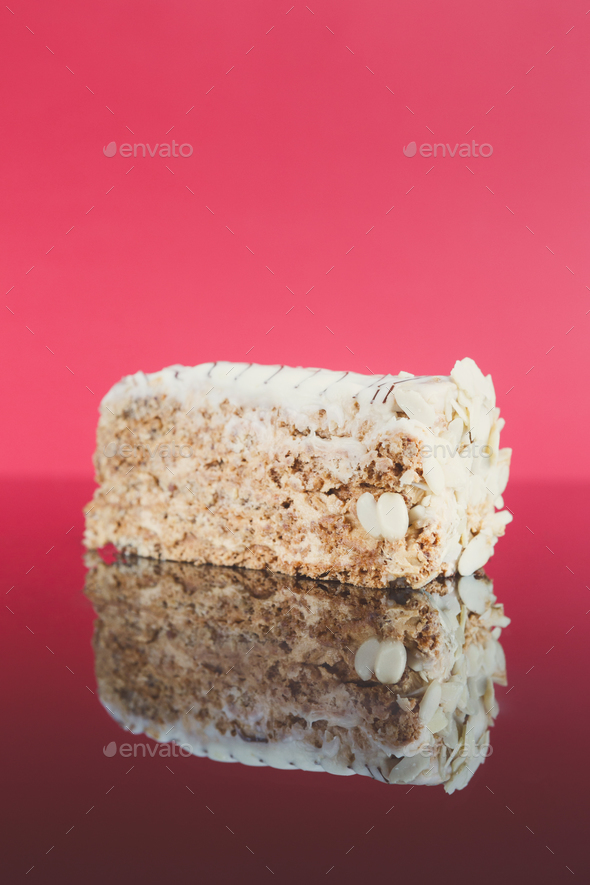 Esterhazy cake slice on mirror table - Stock Photo - Images