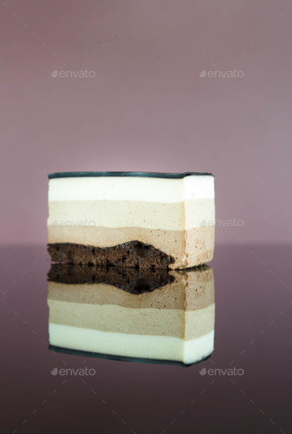 Triple chocolate layer mousse cake with glaze - Stock Photo - Images