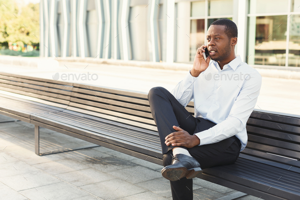 Black businessman outdoors in smart casual ware - Stock Photo - Images