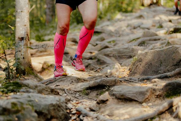 girl runner running rocks - Stock Photo - Images