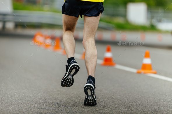 male feet in running shoes - Stock Photo - Images