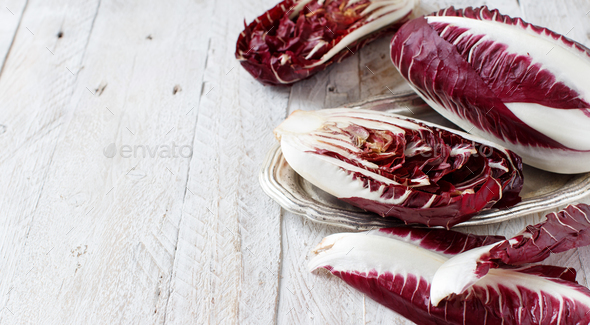 Raw red chicory on a tray close up - Stock Photo - Images
