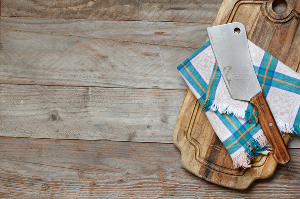 Old hatchet an a cutting board - Stock Photo - Images
