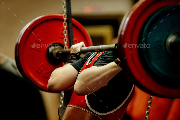 female powerlifter squat barbell - Stock Photo - Images