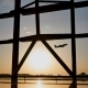 Silhouette of an Airplane Taking Off at Sunset at Beijing Airport in the Background of a Window. - VideoHive Item for Sale