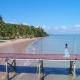 An Asian Girl Walks on a Pier Towards the Beach with Palm Trees - VideoHive Item for Sale
