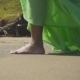 Legs of a Girl Walking Along the Sand in a Green Dress - VideoHive Item for Sale