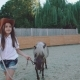 Pretty Girl Walks with a Beautiful Pony on the Arena - VideoHive Item for Sale