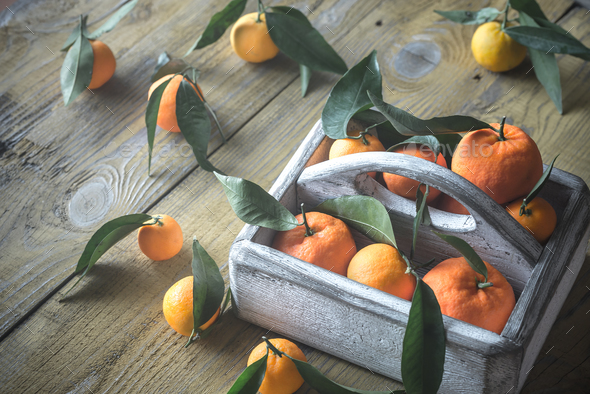 Fresh tangerines in the wooden box - Stock Photo - Images