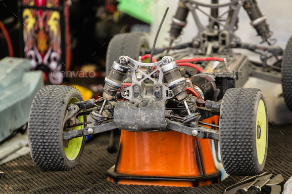 Maintenance of radio-controlled model of the car in a break betw - Stock Photo - Images
