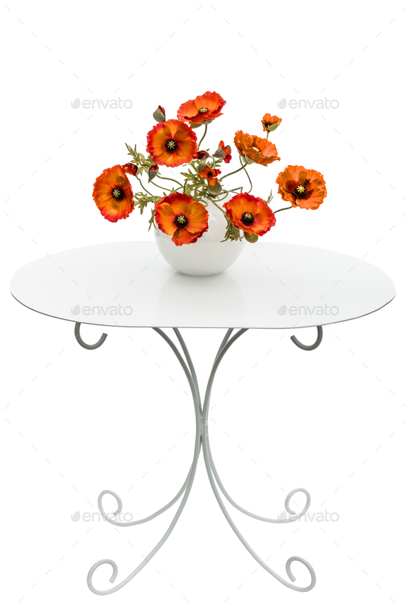 Vase with red poppies is on a coffee table, isolated on a white - Stock Photo - Images
