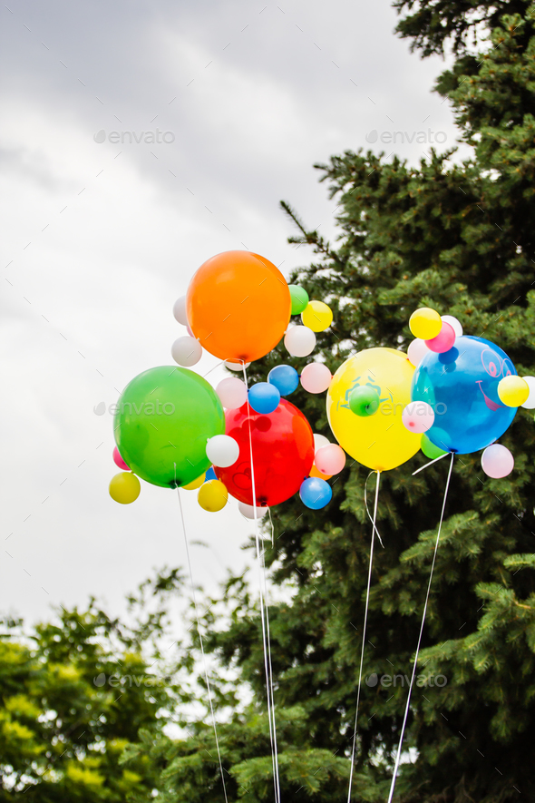 Multicolored balloons against the background of a cloudy sky - Stock Photo - Images