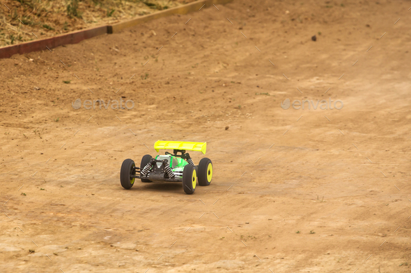 Radio controlled car model in race on dirt track - Stock Photo - Images
