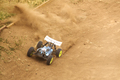 Radio controlled car model in race on dirt track - PhotoDune Item for Sale