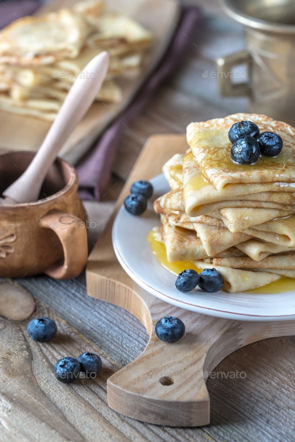 Crepes with fresh blueberries and honey - Stock Photo - Images