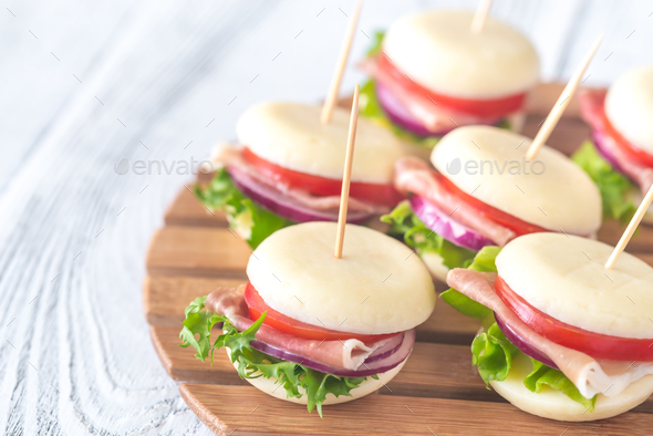 Mini cheese and prosciutto sandwiches - Stock Photo - Images