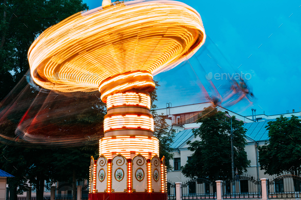 Blurred Motion Effect Of Illuminated Rotating Carousel Merry-Go- - Stock Photo - Images