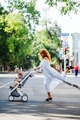 mom with a stroller crosses the road - PhotoDune Item for Sale