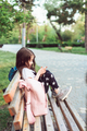 little girl with a smartphone sitting on a bench - PhotoDune Item for Sale