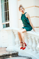 girl in green dress sits on stone handrails - PhotoDune Item for Sale
