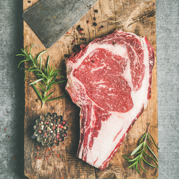 Raw prime beef meat steak rib-eye and chopping knife, flat-lay - Stock Photo - Images