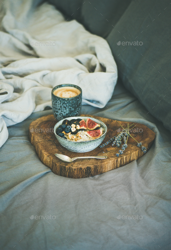 Rice coconut porridge and espresso in bed, copy space - Stock Photo - Images