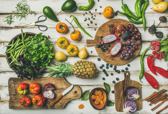 Helathy vegan food cooking background with fruits and vegetables - Stock Photo - Images