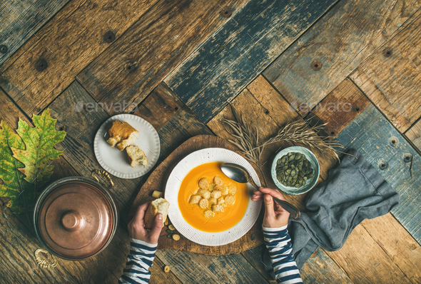 Fall warming pumpkin cream soup, copy space, top view - Stock Photo - Images