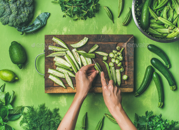 Flat-lay of healthy green vegan cooking ingredients - Stock Photo - Images