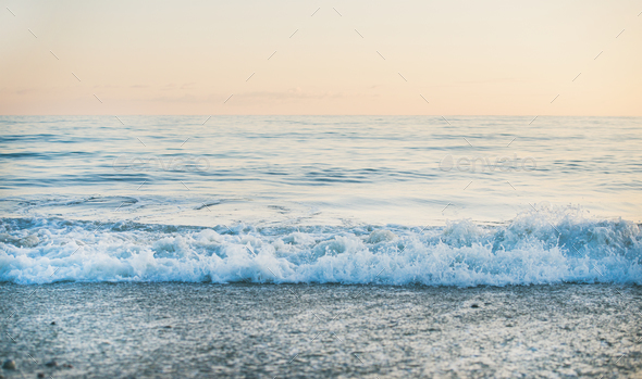Calm Sea and beach view at sunset, pastel colors - Stock Photo - Images