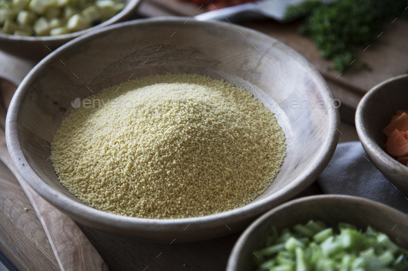 Polenta in Wooden Bowl - Stock Photo - Images