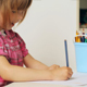 Small Girl Drawing With Colourful Pencils - VideoHive Item for Sale