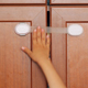 Furniture Safety Lock and Child's Hand on It - VideoHive Item for Sale