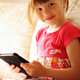 Little Girl Holding the E-book in Her Hands - VideoHive Item for Sale