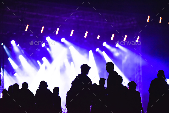 Group of friends enjoying music festival together. Silhouette of friends socializing at a concert - Stock Photo - Images