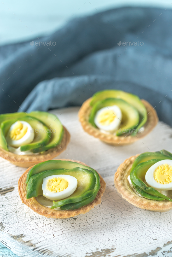 Tartlets with cream cheese, avocado - Stock Photo - Images