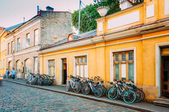 Tallinn, Estonia. Bicycles Rental Bikes Parking Near Old House I - Stock Photo - Images