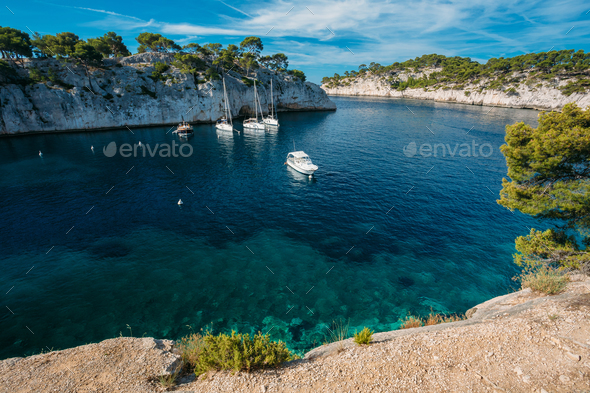 Yachts Boats In Bay. Calanques - A Deep Bay Surrounded By High C - Stock Photo - Images