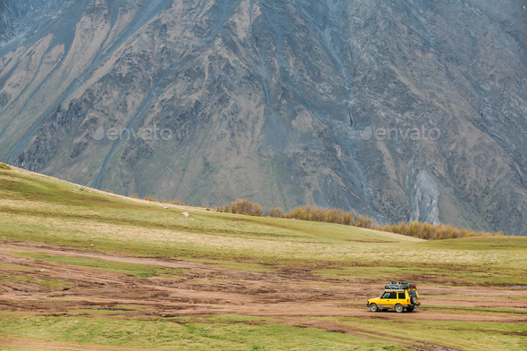 SUV Car On Off Road In Spring Mountains Landscape In Georgia. Dr - Stock Photo - Images