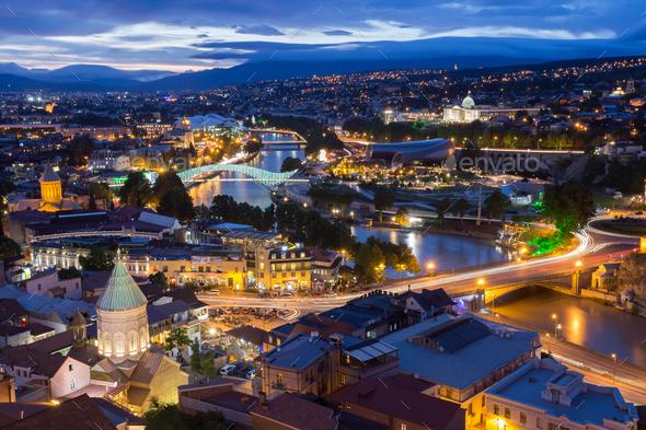 Scenic Top View Of Tbilisi Georgia In Evening Lights Illuminatio - Stock Photo - Images
