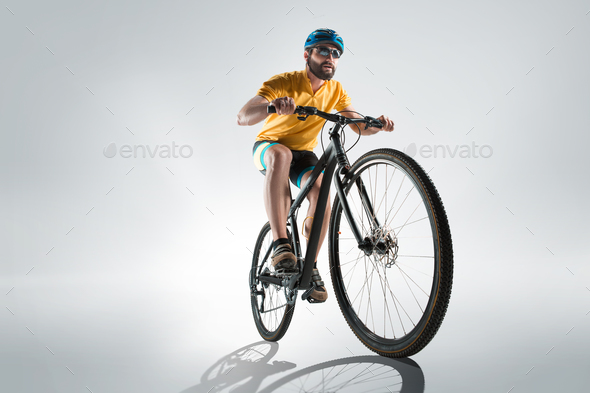 The bicyclist on gray, studio shot. - Stock Photo - Images