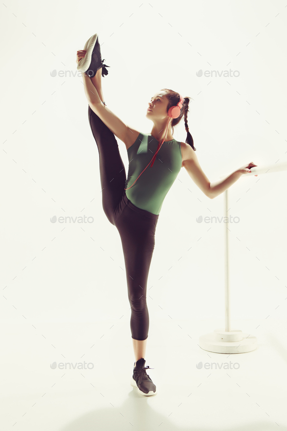 The woman in the dance hall at the ballet machine - Stock Photo - Images