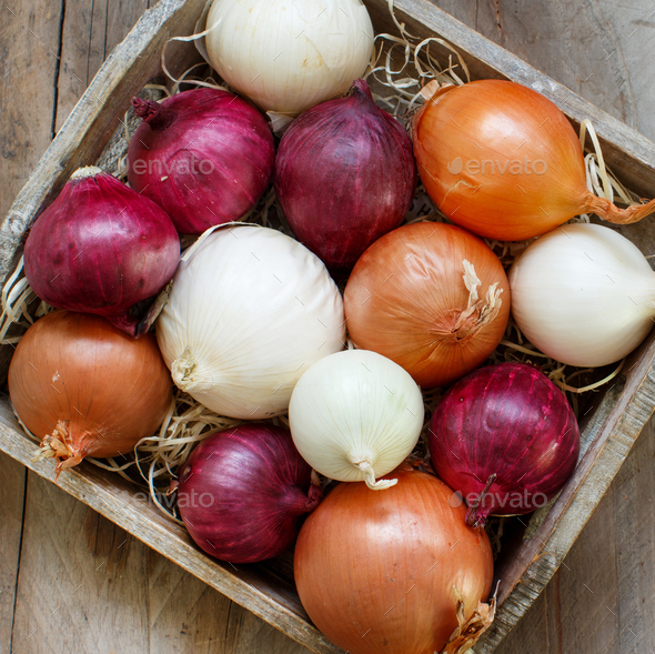Raw onions in basket - Stock Photo - Images